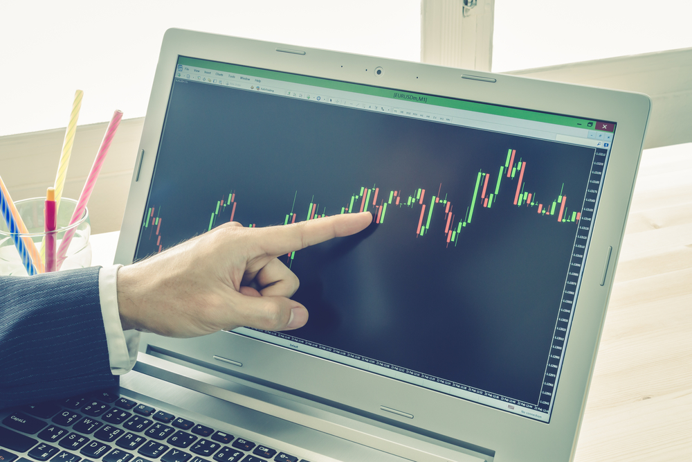 Businessman is pointing stock graph or forex graph